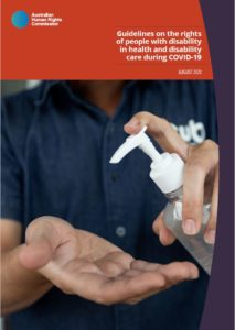 Cover page of AHRC disability and COVID-19 guidelines. Includes a photograph of a health worker using hand sanitiser.